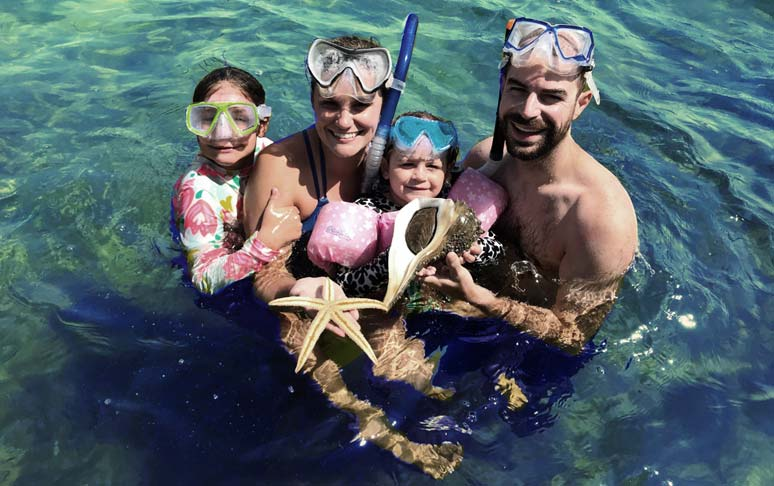 Family snorkeling at Shell Island